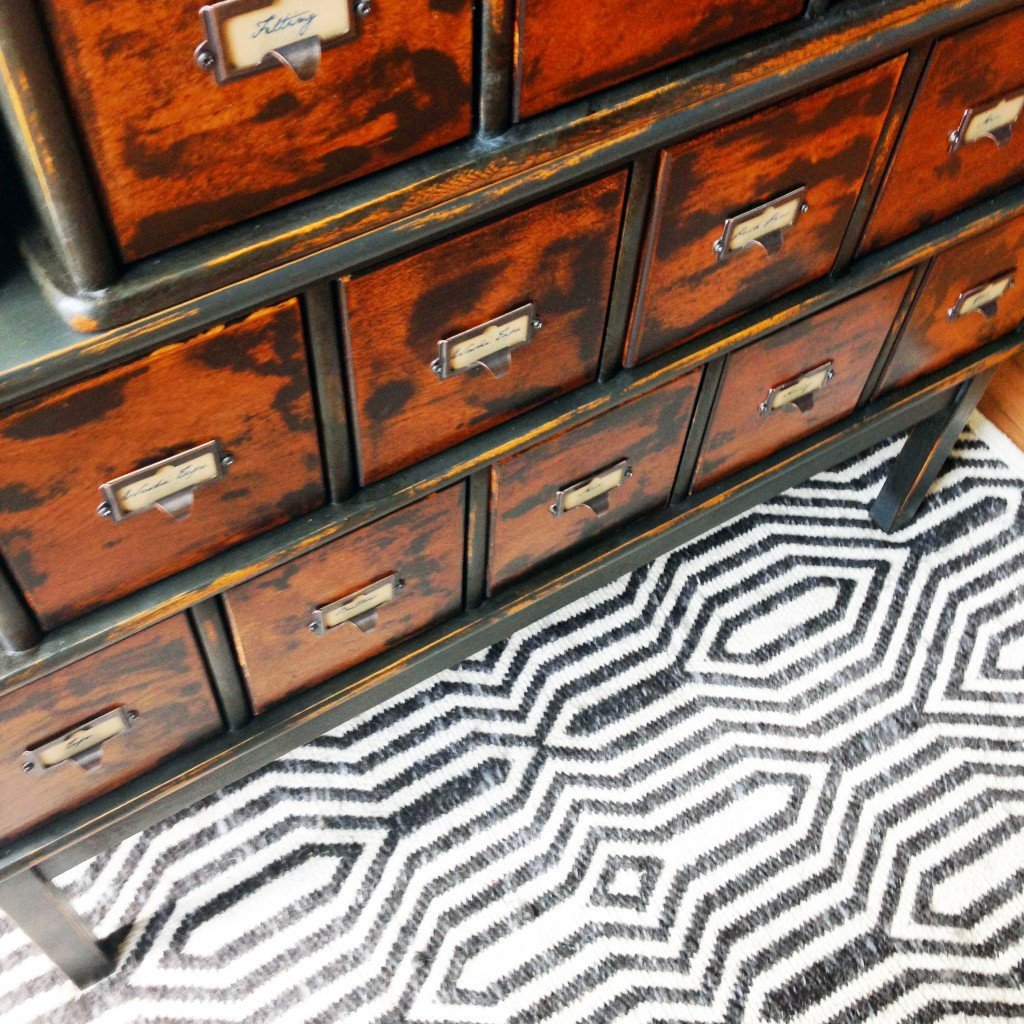 geometric rug with apothecary cabinet